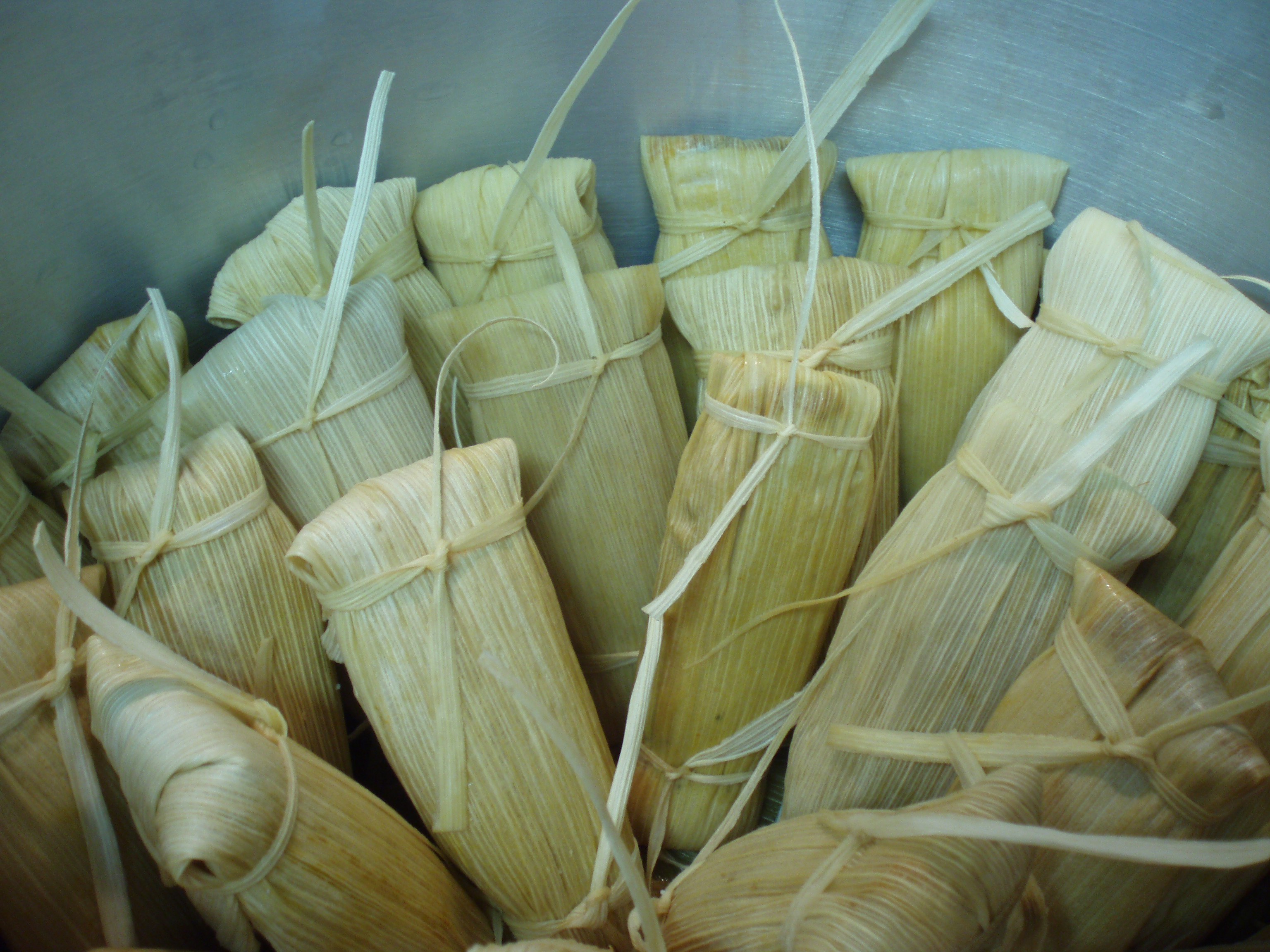 placing tamales in the steamer